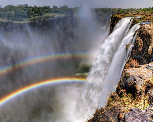 Rainbow over waterfall Victoria