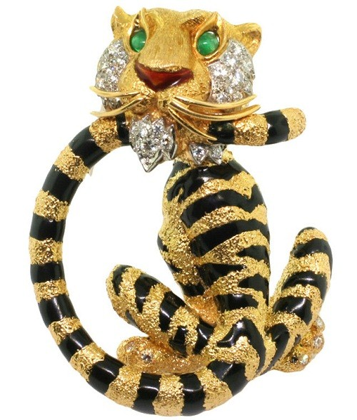 Cartier. A Diamond Emerald and Enamel Brooch. France Circa 1960's