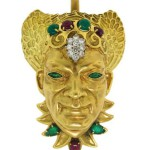 Diamond, Ruby, Emerald & Yellow Gold Mask Pendant by Wander France, Circa 1970's. $7,500