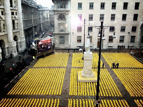 Art installation of yellow helmets protest in Milan