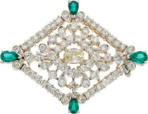 Brooch decorated with diamonds and emeralds