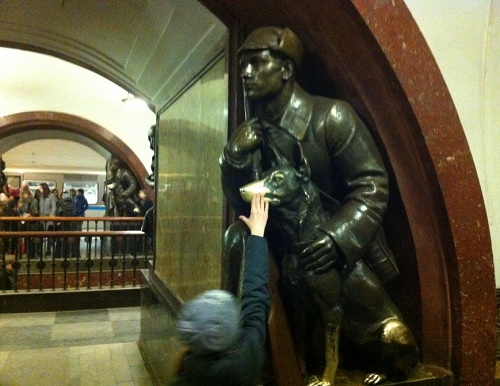 Monuments people rub and kiss. Bronze sculptures by Matvey Manizer at the famous station of the Moscow Metro – Revolution Square station