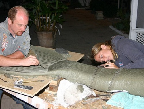 Linden with artist Allan Holt, working on her mermaid tail. The tail time consuming work, it takes months to make it, the material for it - fibreglass mould of Linden's body, high-quality silicone to make it hydro-dynamic