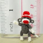 Here is a lovely crocheted monkey. It comes in standing position and is crocheted by embroidery threads, its eyes are sewn black cored plastics and stuffed by polyfil.
