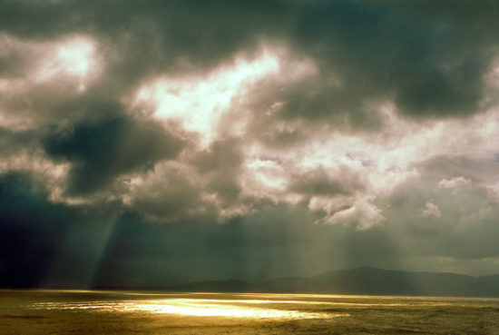 Sun rays beaming down through the clouds, Inch Strand, Inch, Dingle Peninsula, County Kerry, Ireland