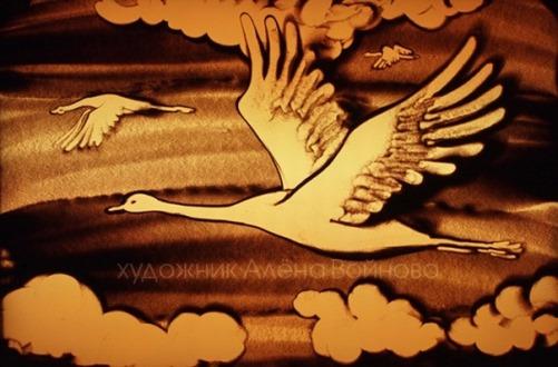 Sand animated art by Alyona Voynova