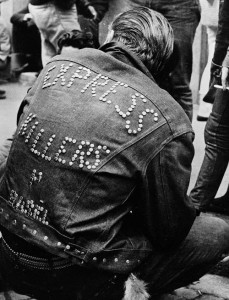 A man in a denim jacket with buttons at the meeting in Zurich in 1962.
