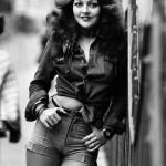 Woman advertises model denim shorts, 1975.