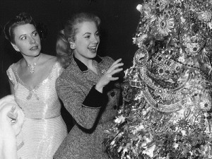 Joan Castle Joseff looks with horror at Shirley Jones, who is trying to touch the tree of jewelry by Joseff