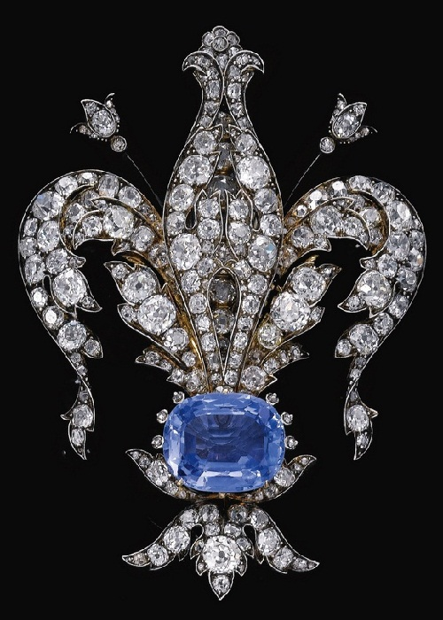 A late-nineteenth-century sapphire and diamond brooch in the form of a fleur-de-lys, symbol of France. (Sotheby's)