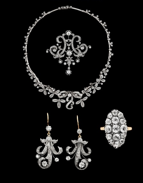A set of diamond jewellery, second half 19th century. Silver gold. Tiara, necklace, brooch, earrings and ring, with old- and antique cut diamonds