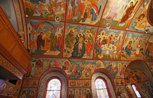 From top to bottom, every space is seen covered in vivid colors thanks to the reverend's careful paintbrush which depicts hundreds of figures in the timeless Byzantine style