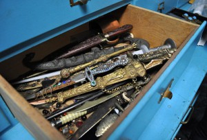 Thousands of pieces of Hollywood history are in boxes and trays. Open a blue box, and you can find snakes, in another one can be a jeweled dagger.
