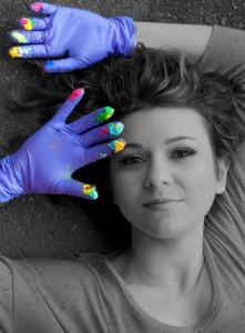 Beautiful artist Iris Scott painting with fingers