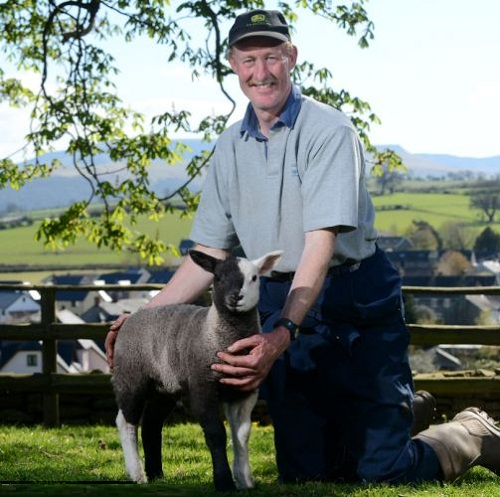 Battenberg, with farmer Richard Griffiths, has two black legs and two white legs and is especially unusual because both his parents are white sheep