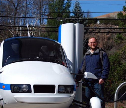 A Terrafugia test pilot fills up the Transition flying car with petrol. The Transition can hold 23 gallons of usable fuel and uses 5gph during flight