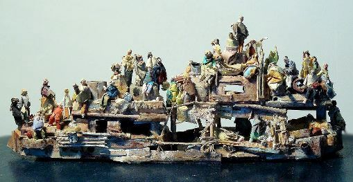 Boat with refugees. Paper, and bits of wood. Made in 2011