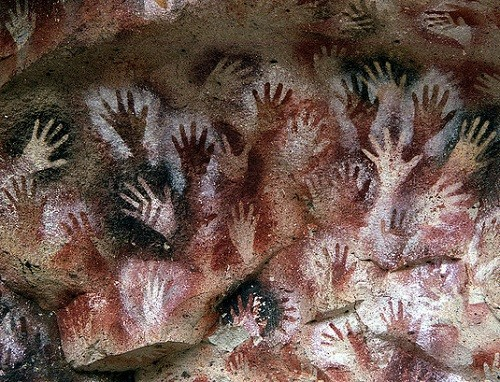 Hands at the Cuevas de las Manos upon Río Pinturas, near the town of Perito Moreno in Santa Cruz Province, Argentina. Photographer Mariano