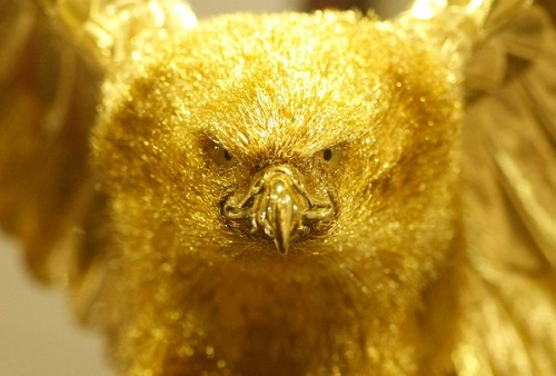 Statue of a bird of prey of gold at an exhibition of gold and silver in the department 'Ginza Tanaka""
