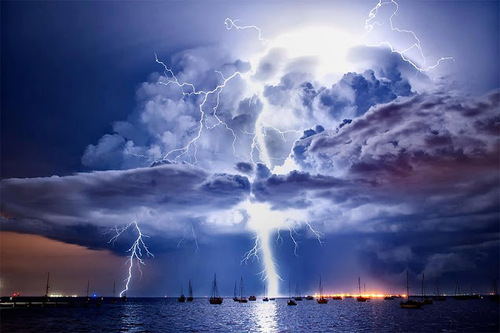 lightning strike over boats