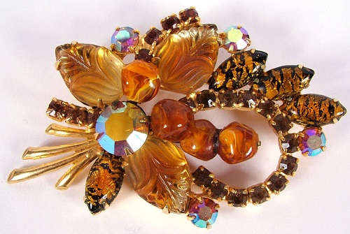 Exceptional Weiss floral pin with various faceted and molded amber colored glass stones