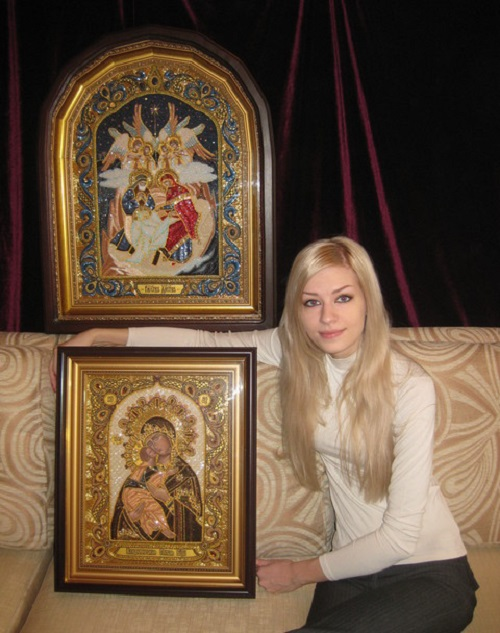 Beautiful Ukrainian artist Angelica Artyomenko with her painted and embroidered icons