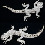 Large and lovely Weiss salamander lizard pin. Reticulated network of white crystal with black jet eyes. Signed on back