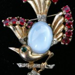 Trifari Vermeil bird pin with cabochon body. Signed on back