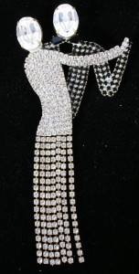 Weiss dancing couple pin. Clear and black jet glass stones with swinging fringe at skirt. Signed on back