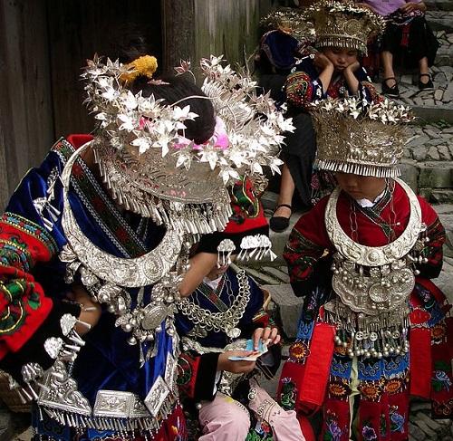Miao girls also from Lang De, Guizhou, awaiting their turn to perform
