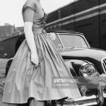 Portrait of heiress Henrietta Tiarks, smiling as she leaves her home to attend her coming-out party at Buckingham Palace, London, April 3rd 1957