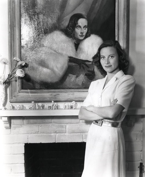 Standing next to her portrait Michele Morgan