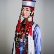 Beautiful costume and jewelry decoration of a Buryat girl