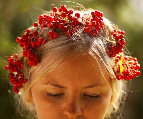 Beautiful blonde girl in a wreath. Red Rowan in Slavic mythology