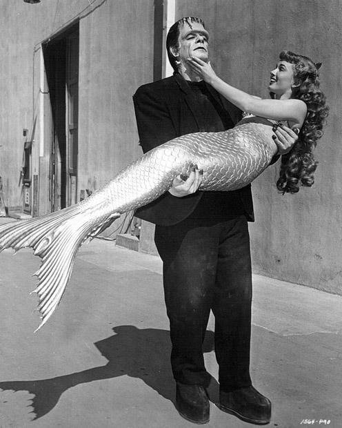 Glenn Strange as Frankenstein's monster, and Ann Blyth as a mermaid, meet on the Universal lot, 1948