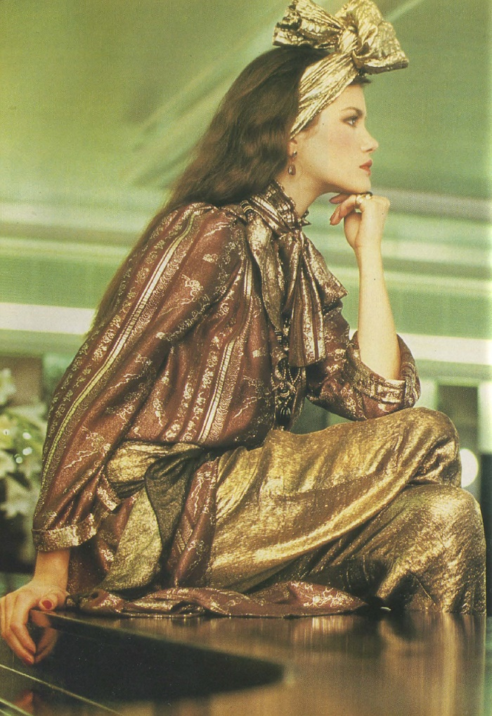 Gorgeous model in golden outfit. Magazine Anglia, January 1983