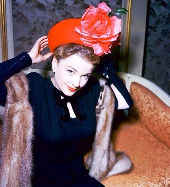In a red hat, Anne Baxter