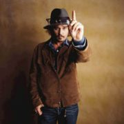 Johnny Depp against brown background