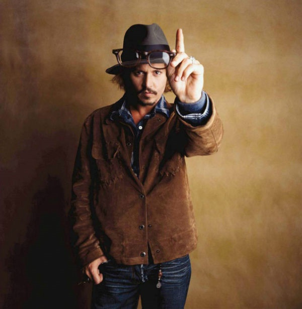 Johnny Depp against brown background