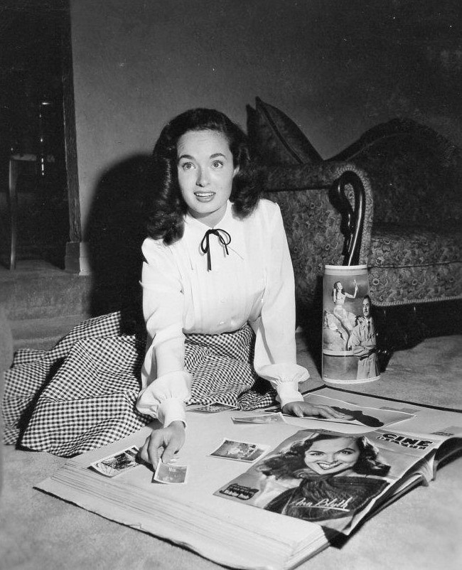 Making a scrapbook, Ann Blyth
