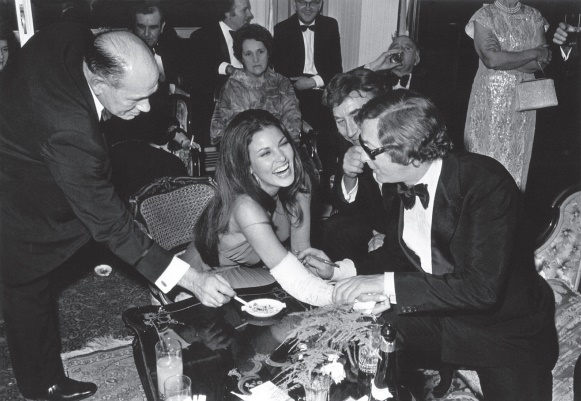 Michael Caine and Raquel Welch enjoy the birthday fun