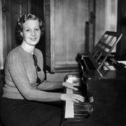 Playing the piano Binnie Barnes