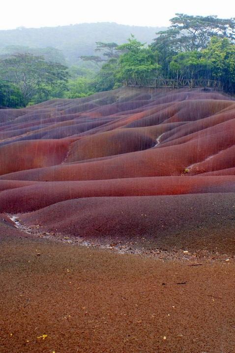 Violet, orange, crimson, colorful sands of Chamarel