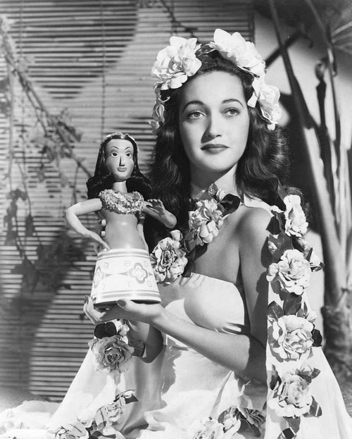 With a doll, Dorothy Lamour